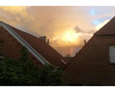 Foto: Abziehendes Gewitter mit Regenbogen