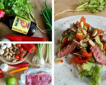 Asiatischer Salat mit mariniertem Rindfleisch und Chili-Erdnüssen